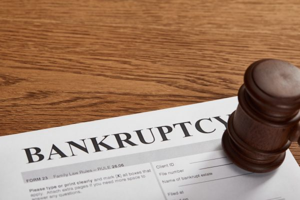 bankruptcy form with wooden gavel on brown wooden table